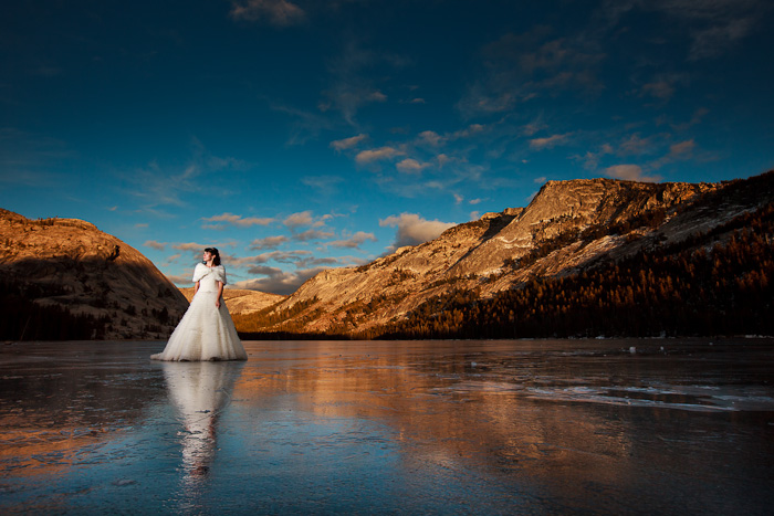 Bride standing on frozen Tenaya Lake on her wedding day